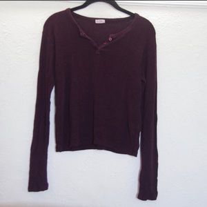 One or two brandy long sleeve shirts